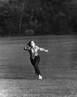 A female student catches a frisbee, 1969