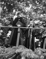 Faculty member bowing during Commencement, 1959