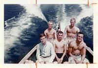 Members of Class of 1958 on motorboat