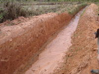 Canal dug to divert (away from ricefields) sediment flows coming from active lavaka