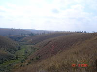 Convex hills and flat valley floor. One lavaka partly hidden on right side