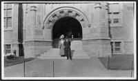 A couple stands in arched doorway