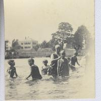 Children and woman in pond