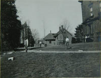 Students playing cricket on the lawn, 1912