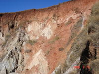 Recent fall of lateritic debris (red) mantling outcrops of saprolite (pale)